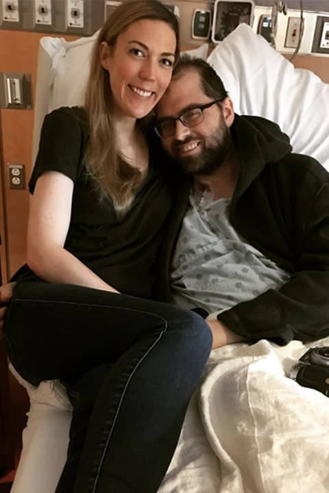 Jessica Blackwell with her husband on hospital bed